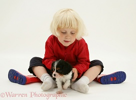 Little girl with Cavalier pup and welly boots