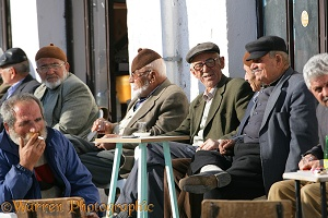 Turkish men drinking tea and smoking