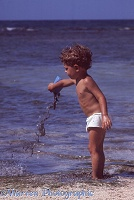 Mark pouring mud on the beach, Jamaica 1968