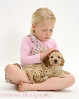 Girl stroking a puppy