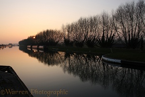 Canal and barge boats at sunset