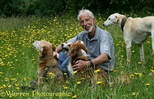 Photographer Kim Taylor with a collection of dogs