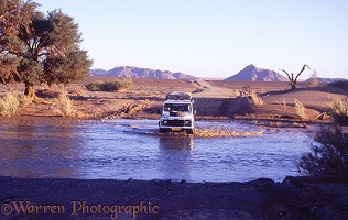 Crossing the Sesreim river, Namibia 1995