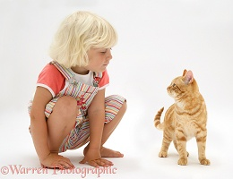 Little girl and ginger cat