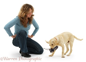 Woman exasperated at disobedient dog