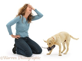 Woman disparing at disobedient dog