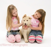 Girls with white Alsatian pup