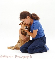 Girl cuddling a brown dog