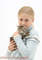 Girl cuddling a cute tabby kitten