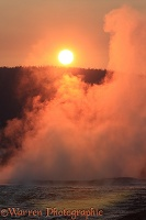 Steaming hot springs at sunset