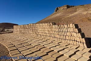 Adobe mud bricks drying and stacked ready for use
