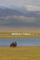 Horse riders and yurts by Song Kul Lake, Kyrgyzstan