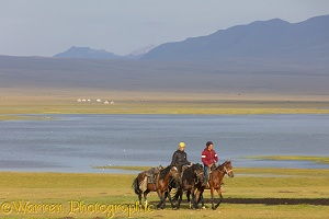 Horse riders by Song Kul Lake, Kyrgyzstan