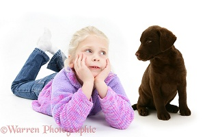 Girl with Chesapeake Bay Retriever puppy