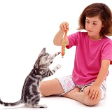 Girl with playful silver tabby cat