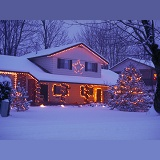 Snowy house with Christmas lights