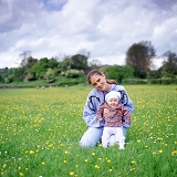 Woman and baby in buttercup field