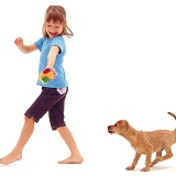 Girl walking with puppy