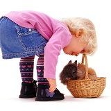 Little girl with rabbits in a basket