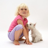 Little girl and Westie pup