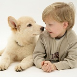Boy with white Alsatian pup