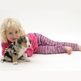 Little girl with merle Border Collie pup