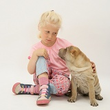 Girl with Shar-pei puppy