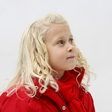 Little girl (5) with red coat and scarf on