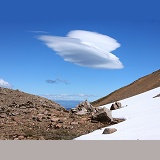 Rugged alpine landscape with lenticular cloud