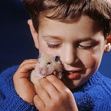 Boy with Golden Hamster